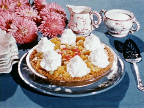 1940s close up fruit salad pie with whipped cream on table / industrial /audio - whipped cream stock videos and b-roll footage