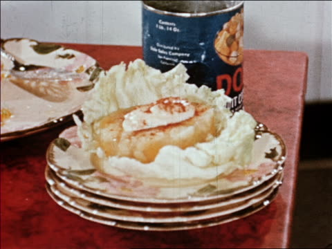 1940s close up gelatin mold on piece of lettuce on dish / mayonnaise and paprika on top / industrial /audio - gelatin stock videos and b-roll footage
