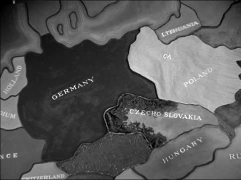 vídeos de stock e filmes b-roll de 1940s close up map of europe with burning to indicate nazi invasion - república checa