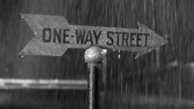 "1940s close up ""One-way Street"" sign at night in rain"