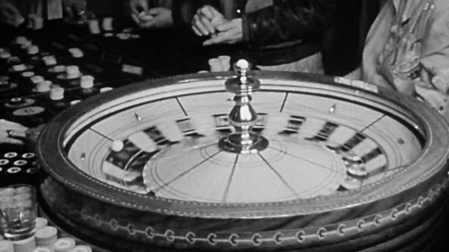 1940s close up roulette wheel spinning at casino table - casino stock-videos und b-roll-filmmaterial