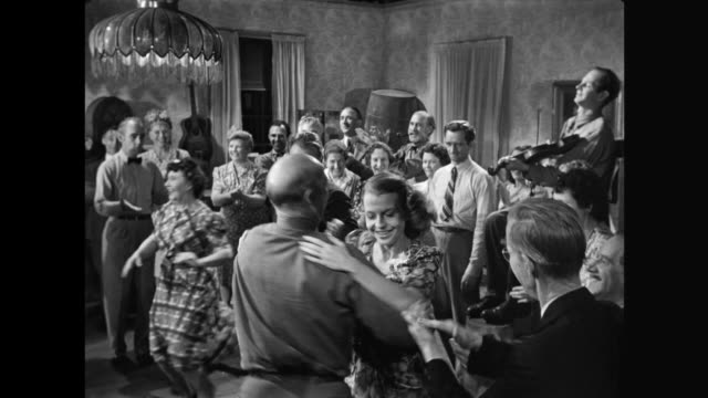 1940s Country folk enjoy the square dancing at party