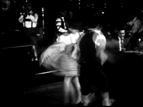 """1940s ms couple in traditional bavarian costumes dancing in circle/ new york, new york"" - german culture stock videos & royalty-free footage"