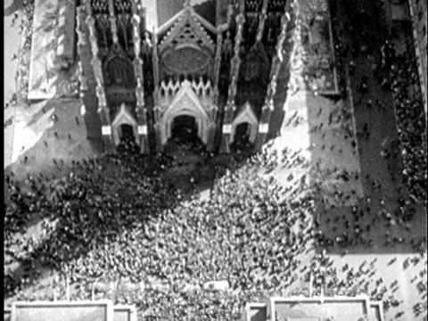 b/w montage 1940s crowd in front of st. patrick's cathedral for easter parade / new york city, new york - kristendom bildbanksvideor och videomaterial från bakom kulisserna