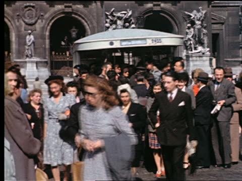 1940s crowd of people walking away from crowded bus pulling away on place de l'opera / paris, france - avenue de l'opera stock videos & royalty-free footage
