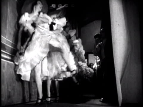 stockvideo's en b-roll-footage met 1940s ws curtain going up and can-can dancers entering stage - 1945