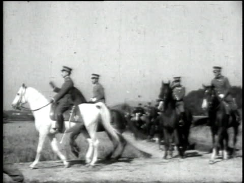 1940s emperor hirohito arriving on white horse accompanied by cavalry troops / japan - recreational horse riding stock videos & royalty-free footage