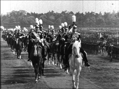 b/w 1940s emperor hirohito riding horse past troops saluting / educational - herbivorous stock videos & royalty-free footage