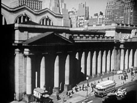 b/w montage 1940s exterior of old penn station / new york city, new york - new york city penn station stock videos and b-roll footage