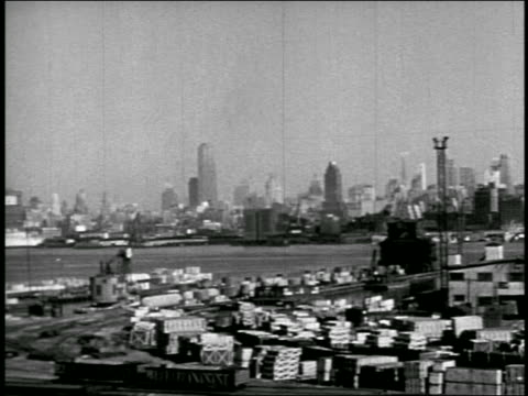 b/w 1940s fade in to wide shot nyc skyline / pan to bus turning on overpass - fade in video transition stock videos & royalty-free footage