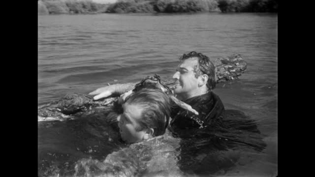 1940s Frantic man swims hard to rescue drowning friend from flood waters