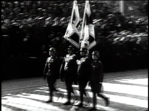 1940s ws goosestepping troops carrying flags / germany - third reich stock videos & royalty-free footage