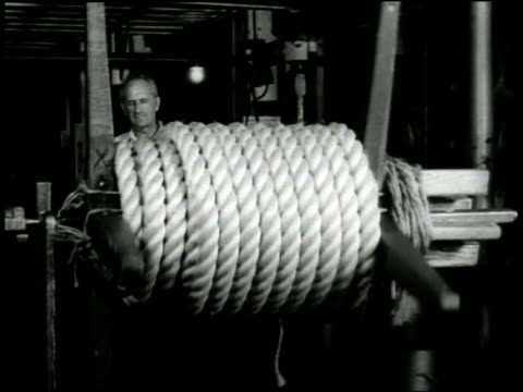 1940s MS Hemp rope being coiled / Boston, Massachusetts, United States