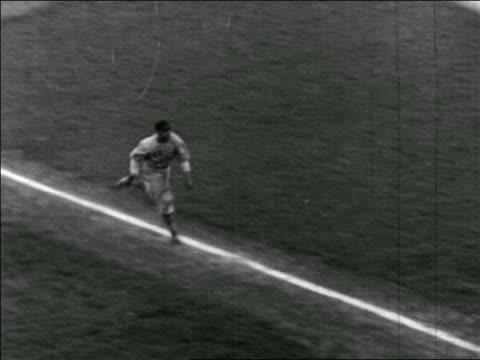 vídeos y material grabado en eventos de stock de b/w 1940s high angle baseball player running home / negro leagues - oficial deportivo