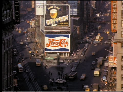 1940s high angle busy Times Square with billboards on buildings / New York City