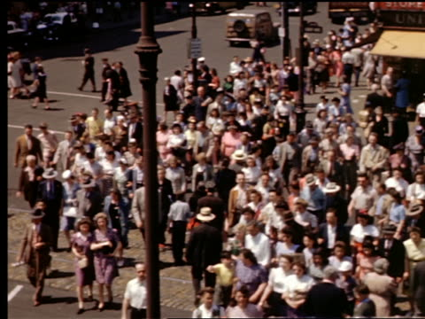 1940s high angle crowds of people crossing surf avenue at coney island / brooklyn, nyc - coney island brooklyn stock videos and b-roll footage