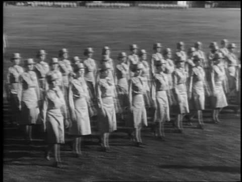b/w 1940s high angle pan rows of waac's in uniform marching in formation outdoors / documentary - womens army corps stock videos & royalty-free footage