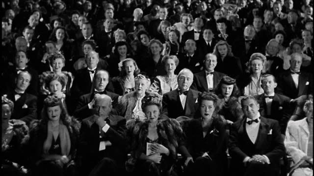 1940s high angle wide shot elegant men and women watching performance in theater audience - theatre building stock videos & royalty-free footage