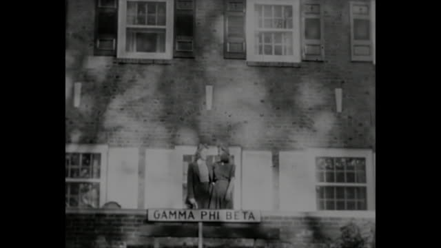 1940s home movie - 2 female students pose for pictures in front of a gamma phi beta sorority sign - university student stock videos & royalty-free footage