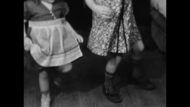 1940s home movie - young sisters dance for camera / plays piano - tap dancing stock videos & royalty-free footage