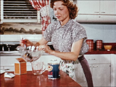 1940s housewife pours fruit salad in gelatin from bowl into can and puts it in refrigerator / indust. - gelatin stock videos and b-roll footage