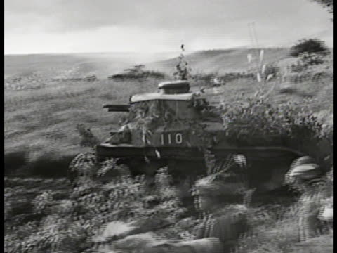 japanese troops soldiers running across open field camouflaged tank passing ws camo tank soldiers running down burning hillside through smoke on... - documentary footage stock videos & royalty-free footage
