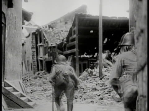 japanese troops soldiers running along building wall through rubble of bombed building leading pack horses from burning town turning horse up in rice... - stillahavskriget bildbanksvideor och videomaterial från bakom kulisserna