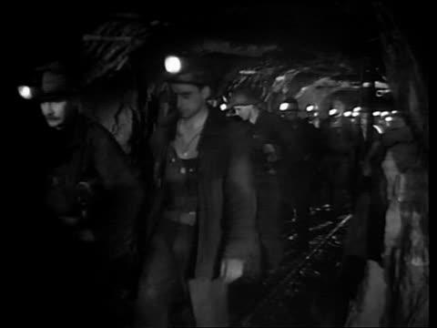 b/w 1940s line of men in mining helmets walking in mine tunnel / south dakota sage - mine shaft stock videos and b-roll footage