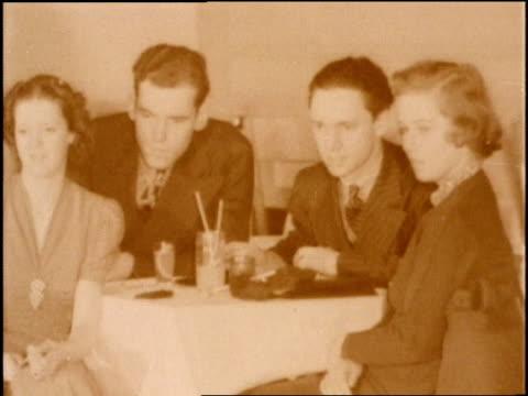 vidéos et rushes de 1940s louis armstrong plays the trumpet at a jazz club. - smoking