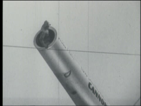 b/w 1940s low angle human cannon ball climbing into cannon + waving at camera / steel pier - artillery stock videos & royalty-free footage