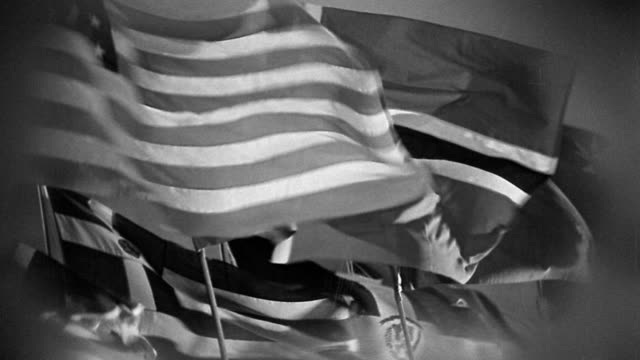 b/w 1940s low angle procession of international flags blowing in wind - former ussr flag stock videos & royalty-free footage