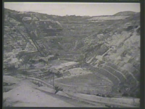 cavern of tin mine. carts moving up hill carrying tin stones . mine worker pushing cart. malaysia - malaysia stock videos & royalty-free footage