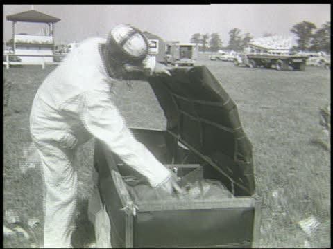 b/w 1940s man crawling into box filled with dynamite - one mid adult man only stock videos & royalty-free footage