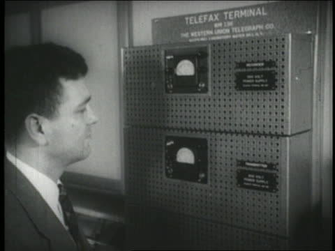 b/w 1940s man looking at gauges of early fax machine - fax machine stock videos & royalty-free footage
