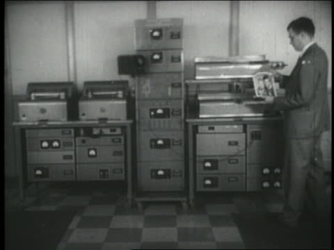 b/w 1940s man operating early fax machine that will transmit photo - fax machine stock videos & royalty-free footage