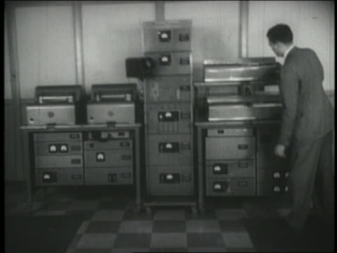 b/w 1940s man operating early fax machine - fax machine stock videos & royalty-free footage