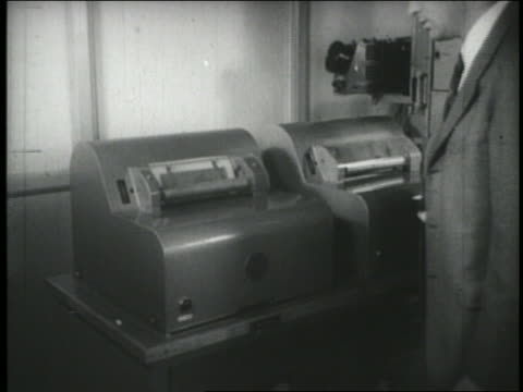 b/w 1940s man waiting for transmission of early fax machine - fax machine stock videos & royalty-free footage