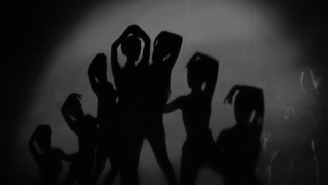 vidéos et rushes de 1940s medium shot curtain opens / silhouetted female dancers performing - peep show