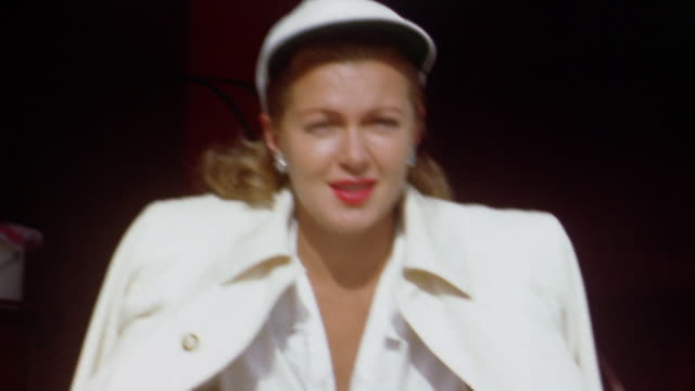vídeos de stock e filmes b-roll de 1940s medium shot lana turner in white cap blouse and jacket smiling and talking - atriz