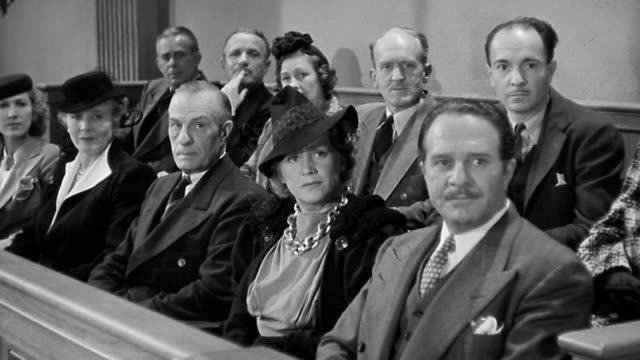 1940s medium shot male and female jurors looking in one direction + listening in courtroom - legal trial stock videos & royalty-free footage