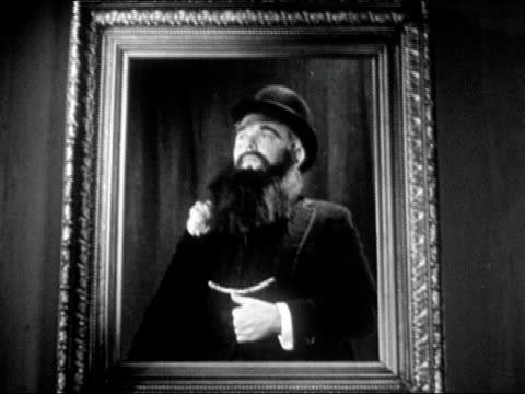 1940s Medium shot man in bowler hat and beard holding pose inside picture frame/ Man turning head and looking surprised/ AUDIO