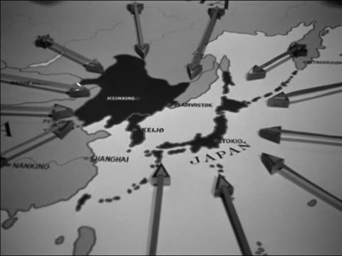 1940s medium shot map of japan and china / shadows of observers' heads around edges of map - authority stock videos & royalty-free footage