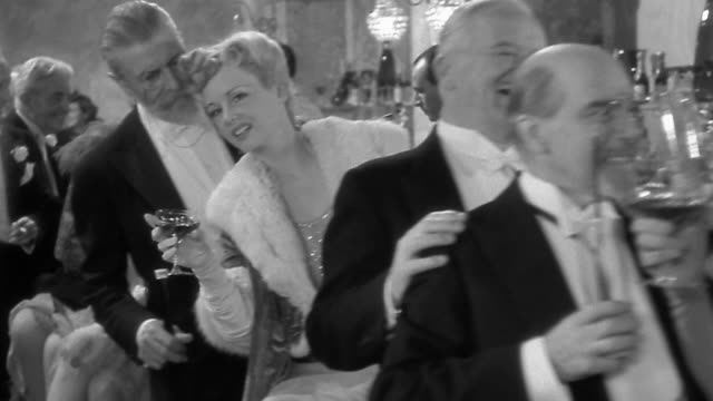 1940s medium shot walking point of view through cocktail party passing smiling people at the bar in formal attire - halbnahe einstellung stock-videos und b-roll-filmmaterial