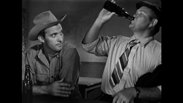 1940s men discuss freedom, money, security and career choices as they drink at the bar - security bar stock videos and b-roll footage