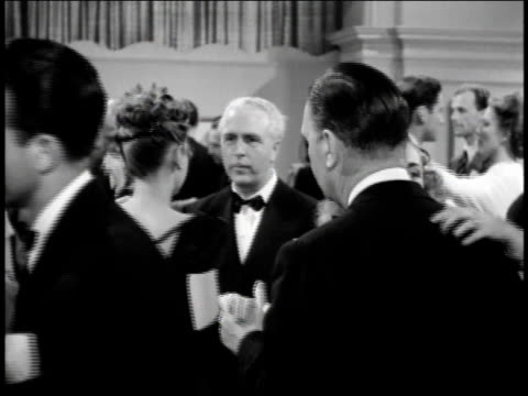 1940s ms men in tuxedos dancing with women in fancy gowns / united states - tuxedo stock videos and b-roll footage