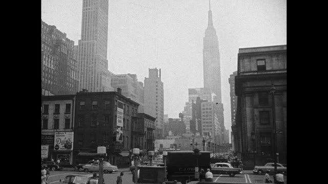 1940s midtown manhattan street scene - empire state building video stock e b–roll