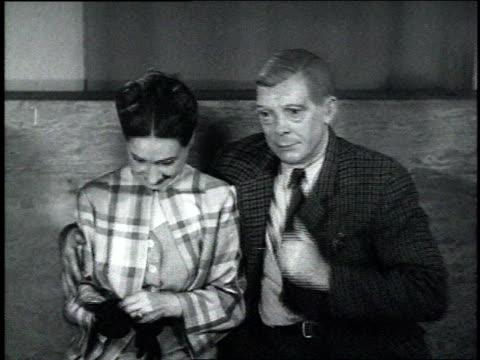 1940s montage a couple wearing lifelike masks of wallis simpson and king edward viii - エドワード8世点の映像素材/bロール