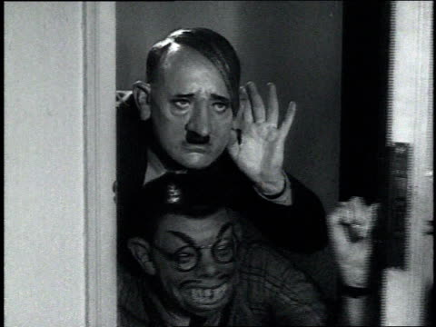 1940s montage actor playing adolf hitler accompanied by a man in a monkey mask and a hirohito mask - kaiser hirohito von japan stock-videos und b-roll-filmmaterial