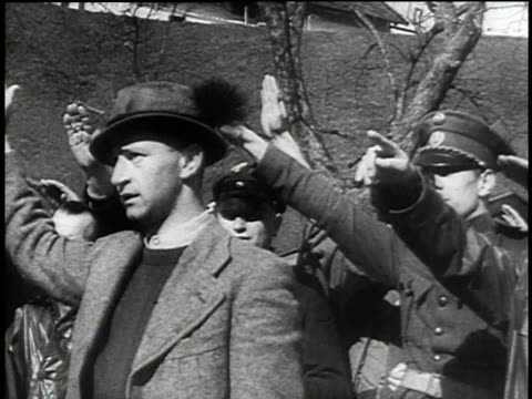 1940s montage austrians cheering and saluting german troops marching on the street / austria - axis powers stock videos & royalty-free footage