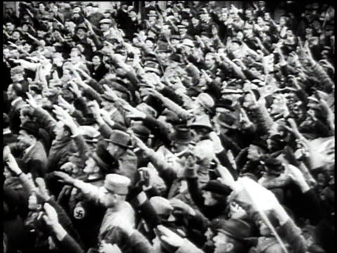1940s montage austrians cheering as german troops march in the street / austria - axis powers stock videos & royalty-free footage